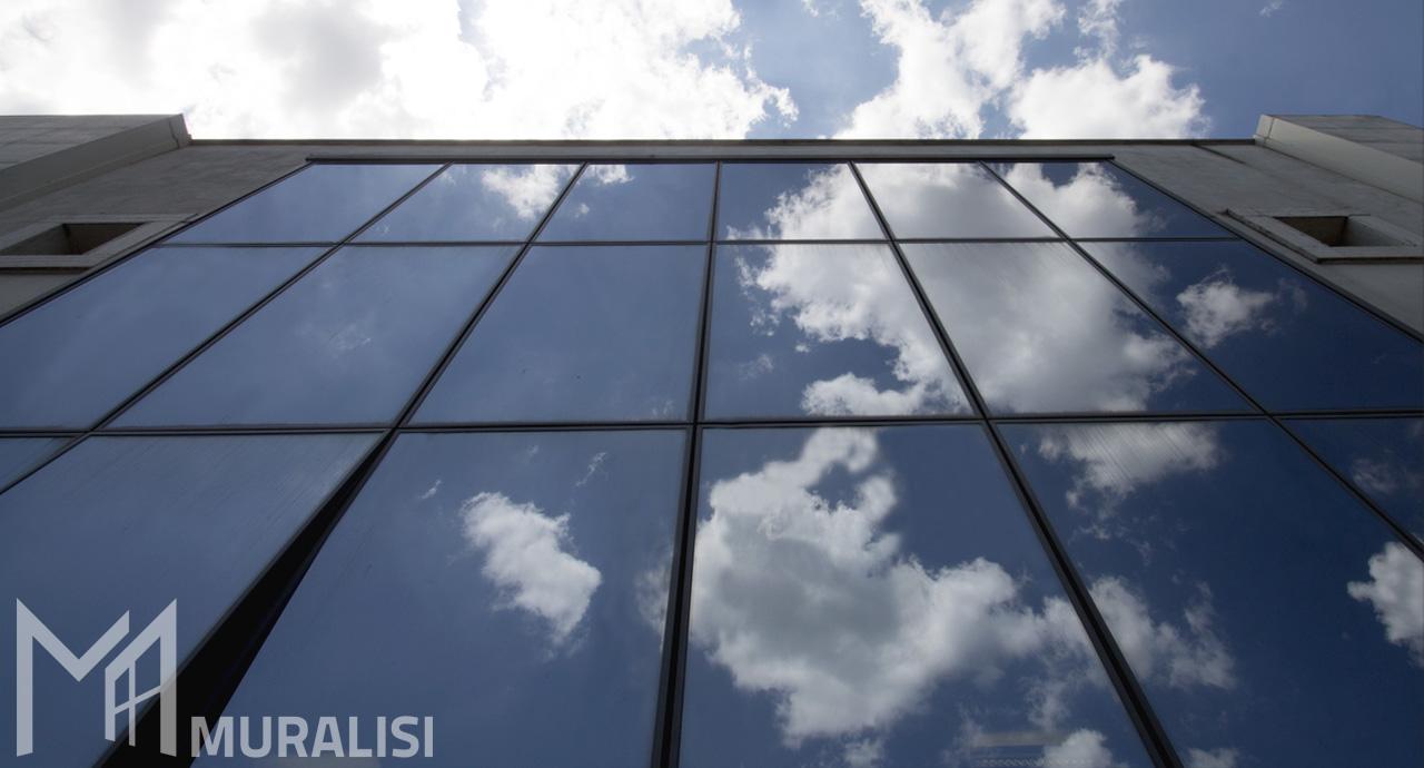 Facciata continua con vetri riflettenti - Banca di credito Cooperativo - Muralisi